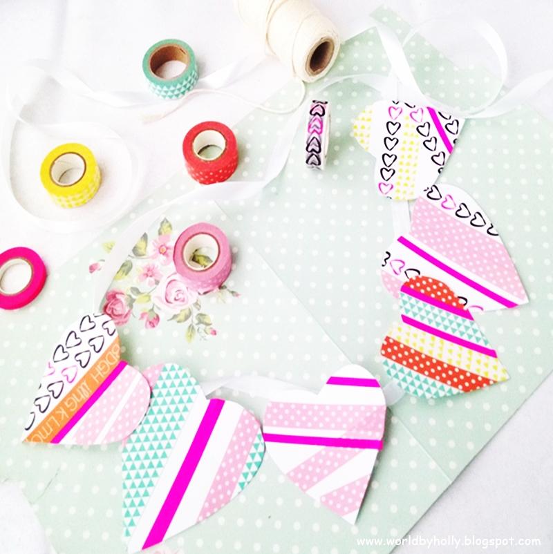 Kolorowa girlanda zrobiona z papierowych serc, ozdobionych taśmami