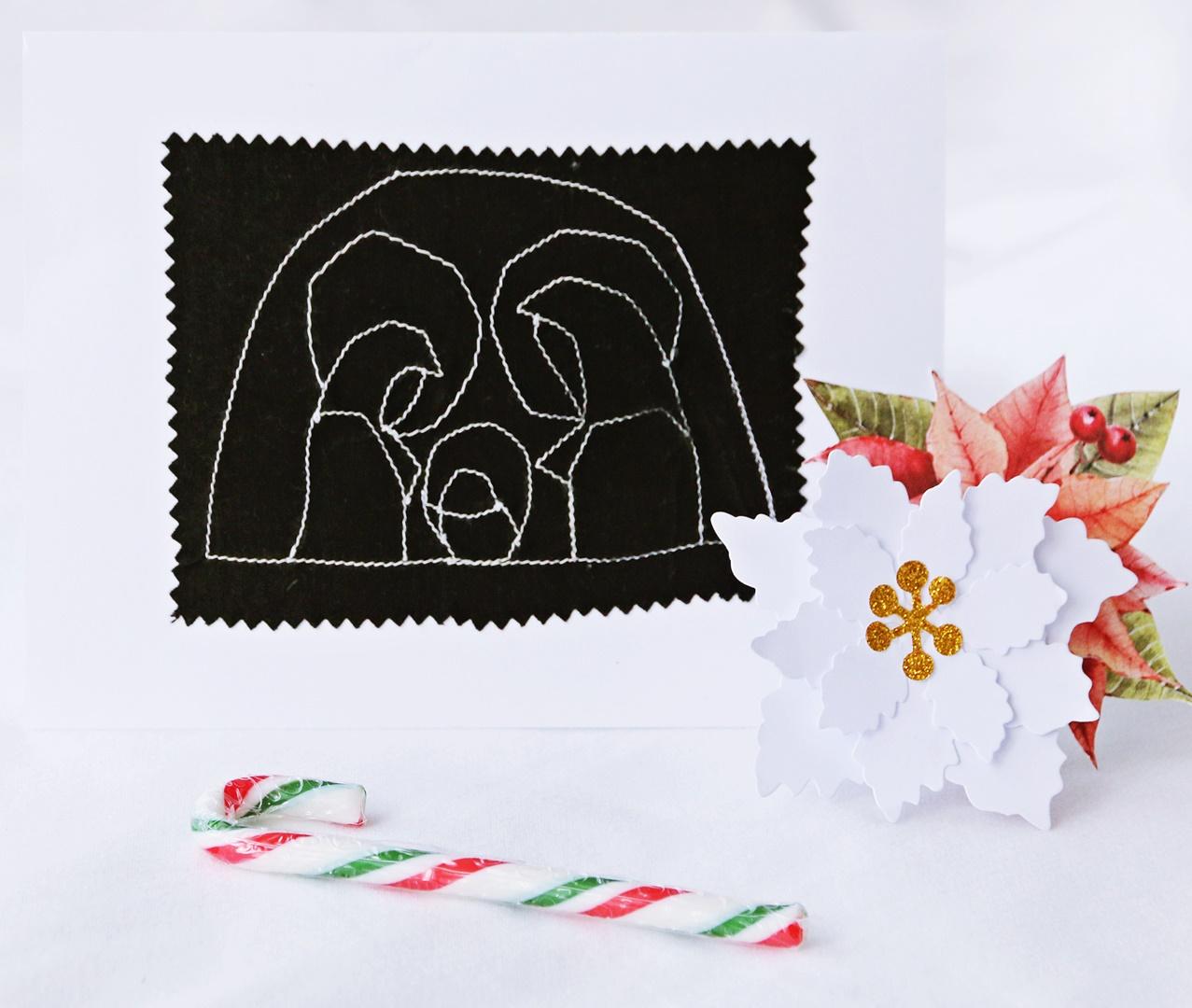 Kartka świąteczna przedstawiająca świętą rodzinę i szopkę
